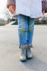 Closeup of child painted jeans