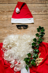 Father Christmas in his costume on wooden background