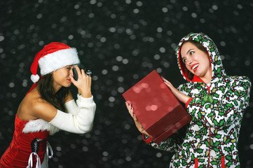 Two young girls with retro camera on a dark background