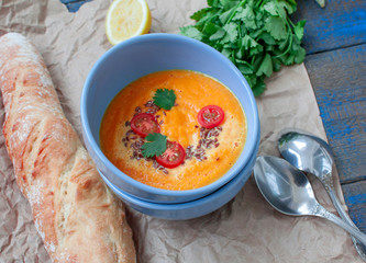 Vegan orange vegetable soup (carrots, sweet potatoes, pumpkin) with herbs and coconut cream.  Perfect for the detox diet or just a healthy meal.  Love for a healthy raw food concept.