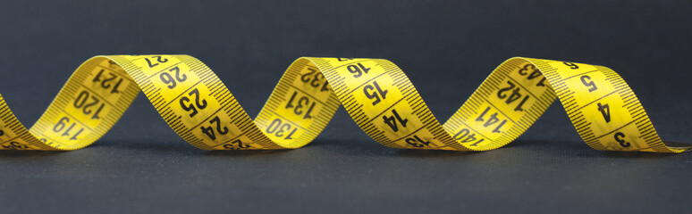 A roll of tape-measure with centimeters isolated on white