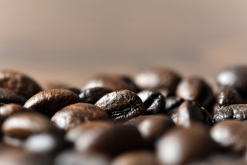 Roasted coffee beans on board close-up
