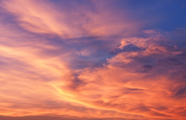 Natural background. The sky at sunset, flaring all shades of the