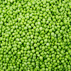 Fresh raw peas. Green background.