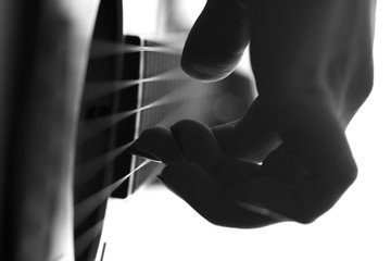 silhouette of a female hands playing a guitar