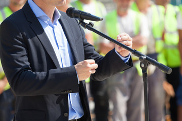 Businessman or politician is giving a speech