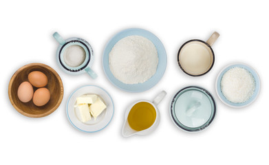 Collection of various cake baking ingredients isolated on white background