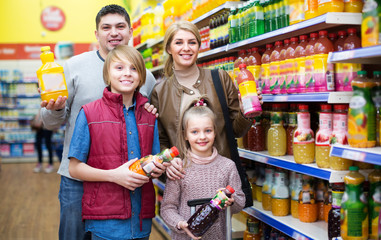 Family purchasing carbonated beverages