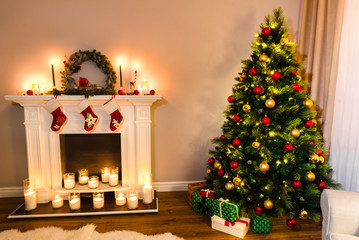 Wonderful new year details, beautiful furry tree with presents under it and a white fireplace full of candles. Xmas Home Interior Decoration, Hanging Sock and Present Toys.