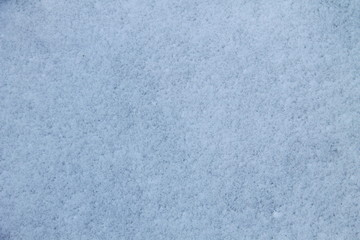 Texture of the white snow. Winter background