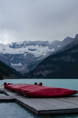 red canoes stacked on dock at Lake Louise