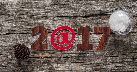 Happy new year 2017 on wood background