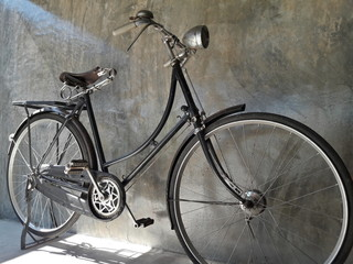 Classic Bike,Bicycle vintage style on Concrete wall in dark tone.