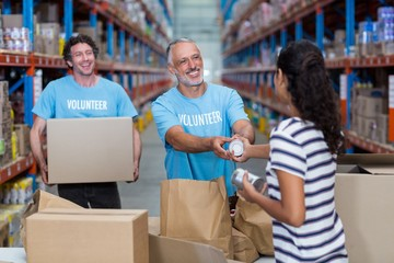 Woman gives some goods to volunteer