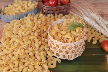 Raw small yellow macaroni pasta for cooking.