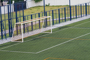 Futsal court in a public outdoor park with artificial turf