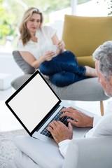 Cropped image of mature man using laptop