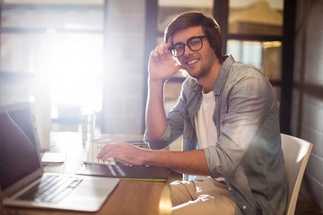 Portrait of smiling man working in office