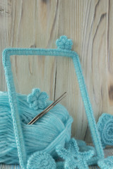 Marine background with cotton lace crochet elements: stars, shells, flowers and frame