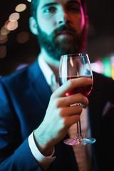 Businessman having glass of wine
