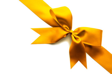 Gold satin ribbon and bow isolated on white