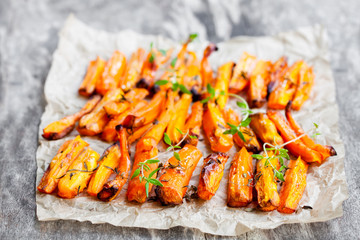Homemade  oven baked carrot chips with thyme
