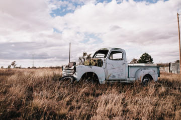 Close-up of an abandoned truck in the field