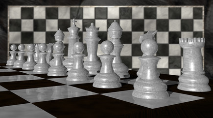 Close up of white chess pieces with blurred chess background