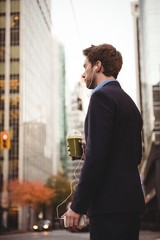 Businessman listening to music on mobile phone