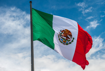 Door stickers Mexico Flag of Mexico over blue cloudy sky