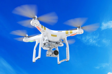 White quadrocopter drone with a video camera 3d