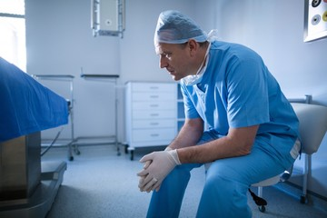 Male surgeon sitting on a chair