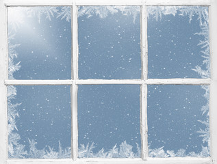 frosty border on weathered windowpane with snowflakes