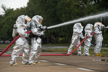 Fire departments & emergency response teams  suited up with PPE