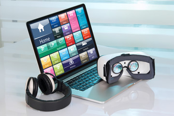 laptop with virtual reality equipment /Computer with virtual reality glasses and headphones