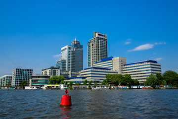 Office towers on the Amstel river in Amsterdam.