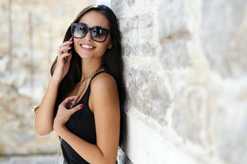 Attractive woman posing while talking on phone