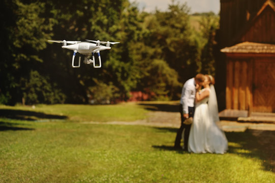 dron filming a wedding couple, a copter shooting 4K video of a bridal couple