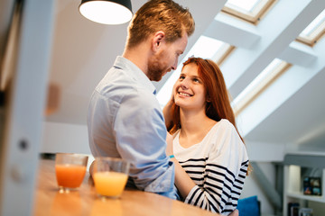 Couple in love talking smiling at home
