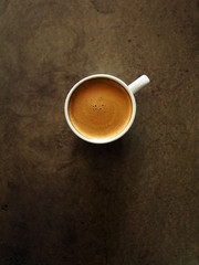 Cup of hot espresso coffee on wood table, black coffee from arab