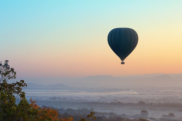 Hot air balloon over plain of Mandalay in Myanmar. this is a vehicle for tourists to see the beautiful scenery during sunrise,sunset over mandalay city.