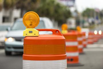 Road closed signs detour traffic temporary barrel arrow light