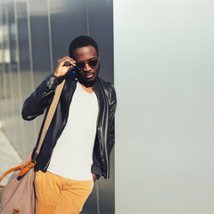 Fashion african man model posing wearing a sunglasses and black