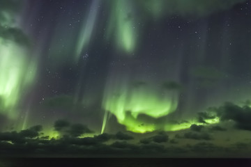 Aurora borealis (Northern Lights) over Arctic ocean