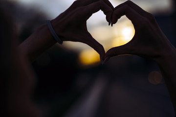 Silhouette of a heart made by hand