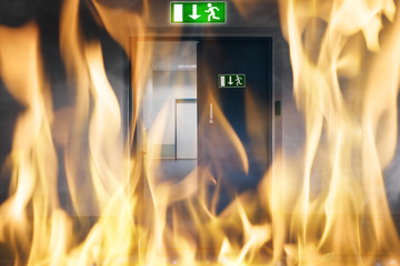 Fire Burning Near An Emergency Exit Door