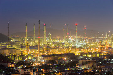 Oil refinery lights night view, industrial landscape background