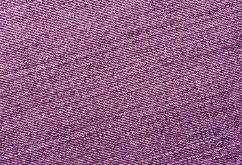 Close-up of pink jeans cloth.