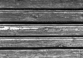 Weathered black and white color wooden house wall.