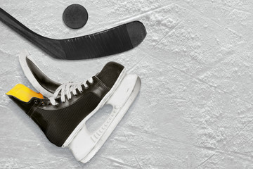 Black hockey stick, skates and the puck